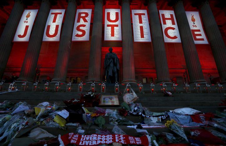 St Georges Hall is illuminated red following a vigil in memory of the victims of the Hillsborough disaster in Liverpool, northern England April 27, 2016.REUTERS/Phil Noble - RTX2BY41