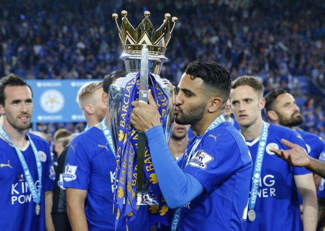 """Britain Soccer Football - Leicester City v Everton - Barclays Premier League - King Power Stadium - 7/5/16 Leicester City's Riyad Mahrez kisses the trophy as he celebrates winning the premier league Reuters / Darren Staples Livepic EDITORIAL USE ONLY. No use with unauthorized audio, video, data, fixture lists, club/league logos or """"live"""" services. Online in-match use limited to 45 images, no video emulation. No use in betting, games or single club/league/player publications. Please contact your account representative for further details. - RTX2DAEO"""