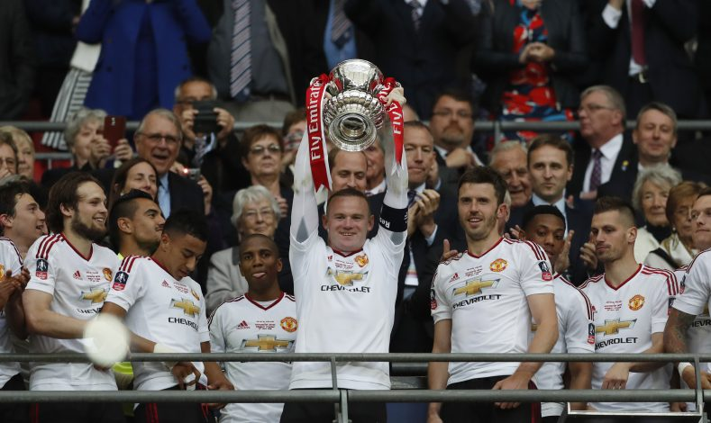 "Britain Football Soccer - Crystal Palace v Manchester United - FA Cup Final - Wembley Stadium - 21/5/16 Manchester United's Wayne Rooney celebrates with the trophy after winning the FA Cup with teammates Action Images via Reuters / John Sibley Livepic EDITORIAL USE ONLY. No use with unauthorized audio, video, data, fixture lists, club/league logos or ""live"" services. Online in-match use limited to 45 images, no video emulation. No use in betting, games or single club/league/player publications. Please contact your account representative for further details. - RTSFBO5"