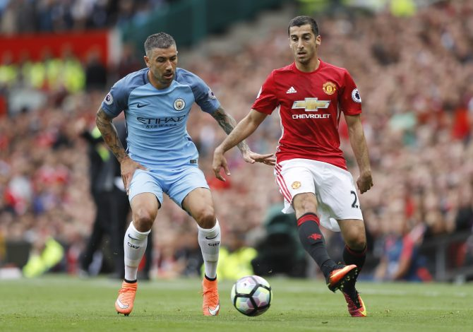 "Britain Soccer Football - Manchester United v Manchester City - Premier League - Old Trafford - 10/9/16 Manchester City's Aleksandar Kolarov in action with Manchester United's Henrikh Mkhitaryan Action Images via Reuters / Carl Recine Livepic EDITORIAL USE ONLY. No use with unauthorized audio, video, data, fixture lists, club/league logos or ""live"" services. Online in-match use limited to 45 images, no video emulation. No use in betting, games or single club/league/player publications. Please contact your account representative for further details. - RTSN3GP"