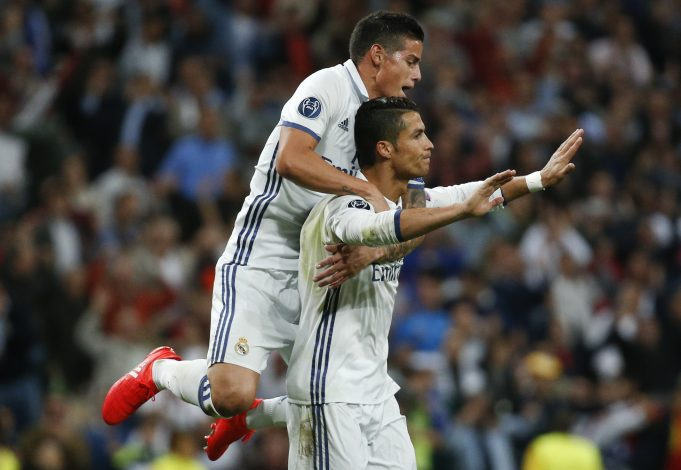 Football Soccer - Real Madrid v Sporting Portugal - UEFA Champions League group stage - Santiago Bernabeu stadium, Madrid, Spain - 14/09/16 Real Madrid's Cristiano Ronaldo celebrates goal with team mate James Rodriguez. REUTERS/Juan Medina - RTSNS3W
