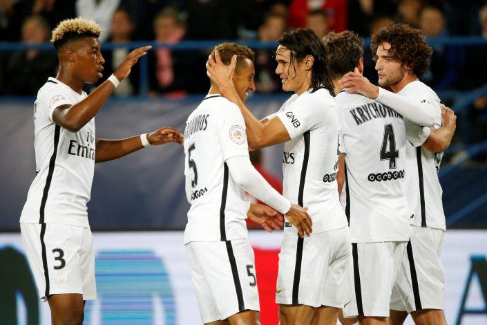 Football Soccer - Caen v Paris Saint Germain - French Ligue 1 - Michel d'Ornano stadium in Caen, France - 16/09/16. Paris' Edinson Cavani (R) celebrates with Marquinhos (L) after scoring his third goal. REUTERS/Charles Platiau - RTSO3P1
