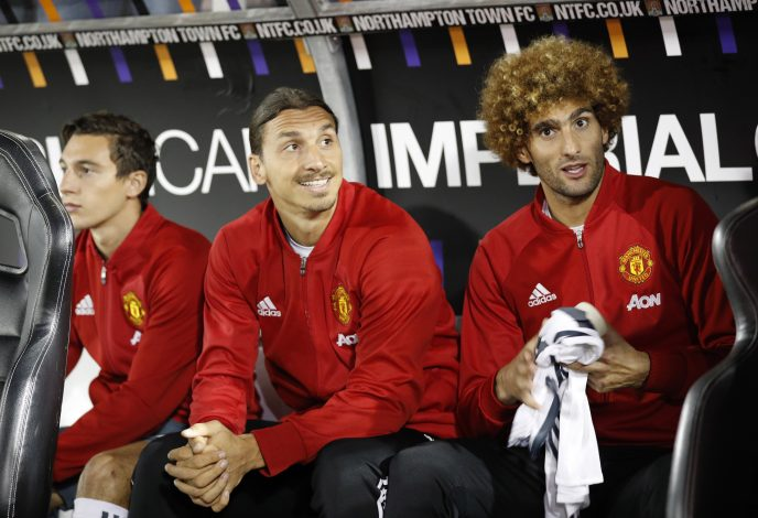 """Britain Football Soccer - Northampton Town v Manchester United - EFL Cup Third Round - Sixfields Stadium - 21/9/16 Manchester United's Matteo Darmian, Zlatan Ibrahimovic and Marouane Fellaini sat on the substitutes bench Reuters / Darren Staples Livepic EDITORIAL USE ONLY. No use with unauthorized audio, video, data, fixture lists, club/league logos or """"live"""" services. Online in-match use limited to 45 images, no video emulation. No use in betting, games or single club/league/player publications. Please contact your account representative for further details. - RTSOTVU"""