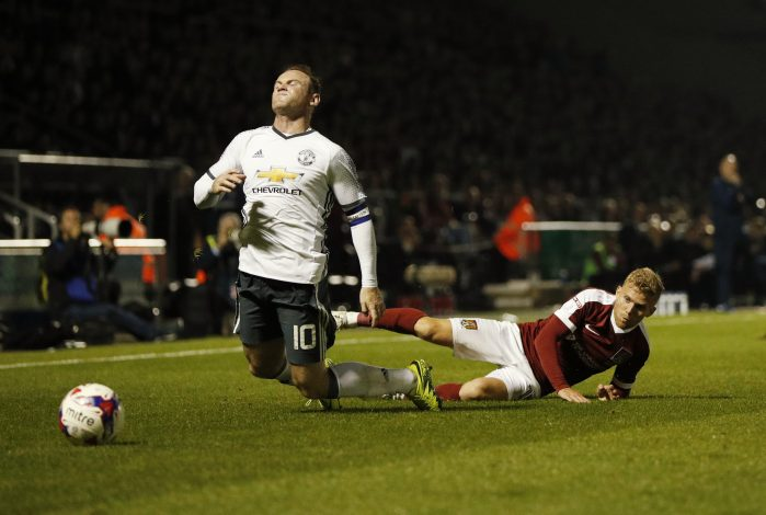 "Britain Football Soccer - Northampton Town v Manchester United - EFL Cup Third Round - Sixfields Stadium - 21/9/16 Manchester United's Wayne Rooney is fouled by Northampton Town's Alfie Potter Action Images via Reuters / John Sibley Livepic EDITORIAL USE ONLY. No use with unauthorized audio, video, data, fixture lists, club/league logos or ""live"" services. Online in-match use limited to 45 images, no video emulation. No use in betting, games or single club/league/player publications. Please contact your account representative for further details. - RTSOUNM"