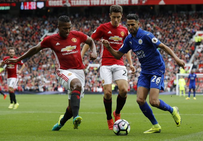 "Britain Football Soccer - Manchester United v Leicester City - Premier League - Old Trafford - 24/9/16 Leicester City's Riyad Mahrez in action with Manchester United's Ander Herrera and Antonio Valencia Reuters / Darren Staples Livepic EDITORIAL USE ONLY. No use with unauthorized audio, video, data, fixture lists, club/league logos or ""live"" services. Online in-match use limited to 45 images, no video emulation. No use in betting, games or single club/league/player publications. Please contact your account representative for further details. - RTSP84I"