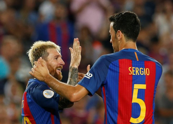 Football Soccer - Barcelona v Sevilla - Spanish SuperCup second leg - Camp Nou stadium, Barcelona , Spain - 18/08/16 Barcelona's Lionel Messi and Sergio Busquets celebrate a goal against Sevilla. REUTERS/Albert Gea - RTX2LMW8