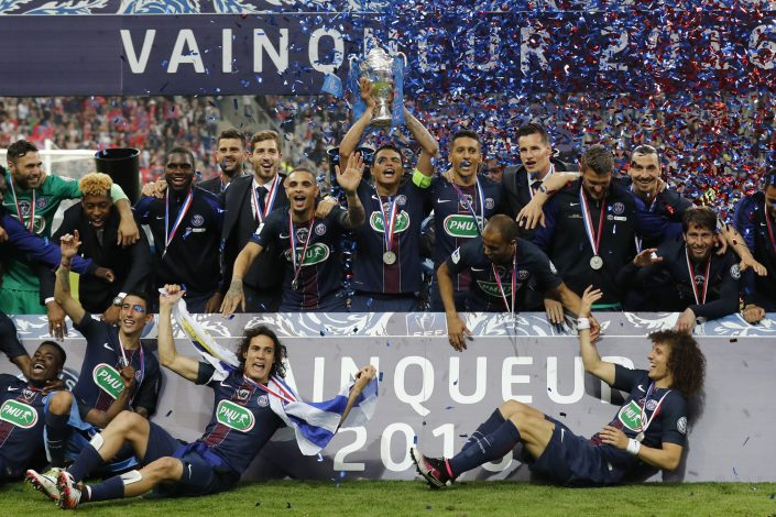 Football Soccer - Olympique Marseille v Paris St Germain - France Cup Final - Stade de France, Saint-Denis, France - 21/05/2016. Paris St Germain team celebrates with trophy after victory their French Cup final soccer match. REUTERS/Benoit Tessier TPX IMAGES OF THE DAY - RTSFC07