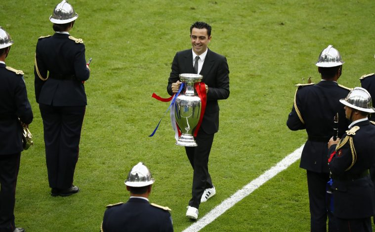 Football Soccer - Portugal v France - Euro 2016 - Final - Stade de France, Saint-Denis near Paris, France - 10/7/16 - Spain's Xavi carries the trophy on the pitch before the match. REUTERS/Christian Hartmann - RTSH7CB