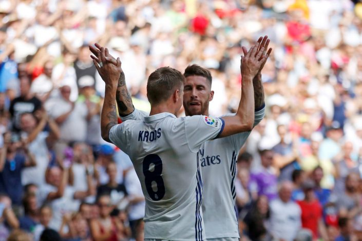 Football Soccer - Spanish Liga Santander - Real Madrid v Osasuna- Santiago Bernabeu, Madrid, Spain 10/09/16. Real Madrid's Sergio Ramos celebrates his first goal with his teammate Toni Kroos (L) during the match. REUTERS/Juan Medina - RTSN4F1