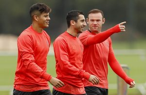 Britain Soccer Football - Manchester United Training - Manchester United Training Ground - 28/9/16 Manchester United's Marcos Rojo, Henrikh Mkhitaryan and Wayne Rooney during training Action Images via Reuters / Jason Cairnduff Livepic EDITORIAL USE ONLY. - RTSPTER