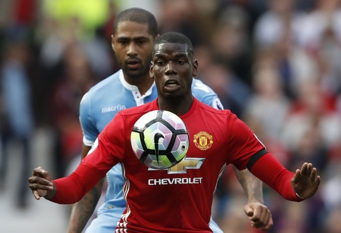 Britain Soccer Football - Manchester United v Stoke City - Premier League - Old Trafford - 2/10/16 Manchester United's Paul Pogba in action with Stoke City's Glen Johnson  Action Images via Reuters / Carl Recine Livepic EDITORIAL USE ONLY. - RTSQE1J