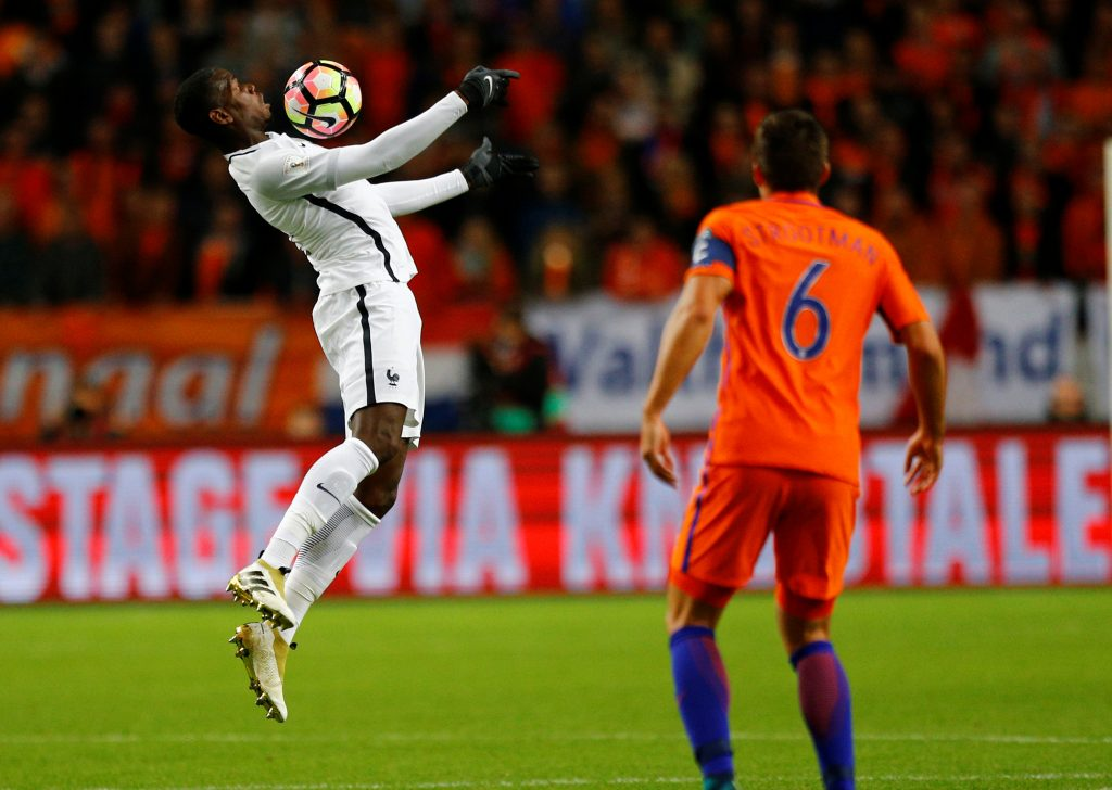 Football Soccer - Netherlands v France - World Cup 2018 Qualifier - Arena Stadion, Amsterdam, 10/10/16. France's Paul Pogba in action as Netherlands' Kevin Strootman watches. REUTERS/Michael Kooren - RTSRNX1