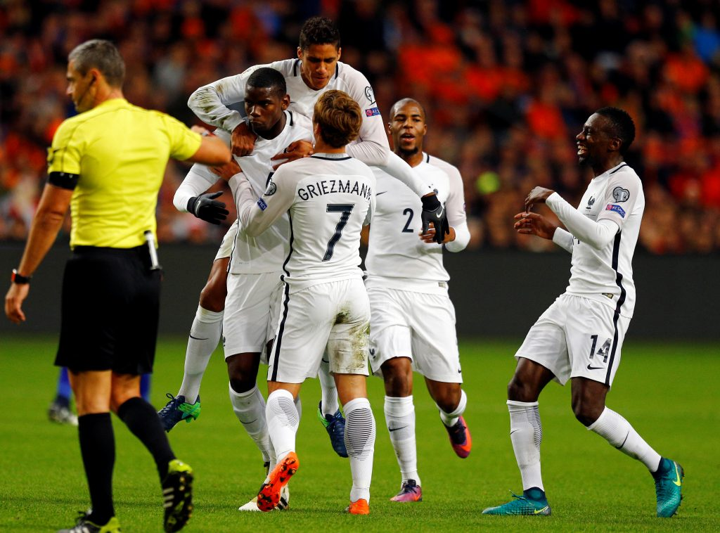 Football Soccer - Netherlands v France - World Cup 2018 Qualifier - Arena Stadion, Amsterdam, 10/10/16. France's Paul Pogba celebrates with team mates after scoring a goal. REUTERS/Michael Kooren - RTSRNYA