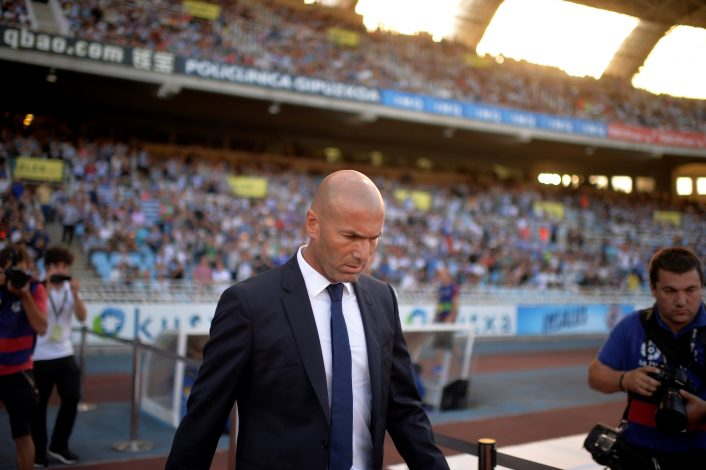Football Soccer - Spanish Liga Santander - Real Sociedad v Real Madrid - Anoeta, San Sebastian, Spain 21/08/16. Real Madrid coach Zinedine Zidane arrives enters the pitch before the match. REUTERS/Vincent West - RTX2MG44