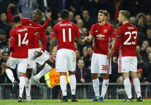 Britain Football Soccer - Manchester United v Fenerbahce SK - UEFA Europa League Group Stage - Group A - Old Trafford, Manchester, England - 20/10/16 Manchester United's Paul Pogba celebrates scoring their third goal with teammates Action Images via Reuters / Jason Cairnduff Livepic EDITORIAL USE ONLY. - RTX2PRT4