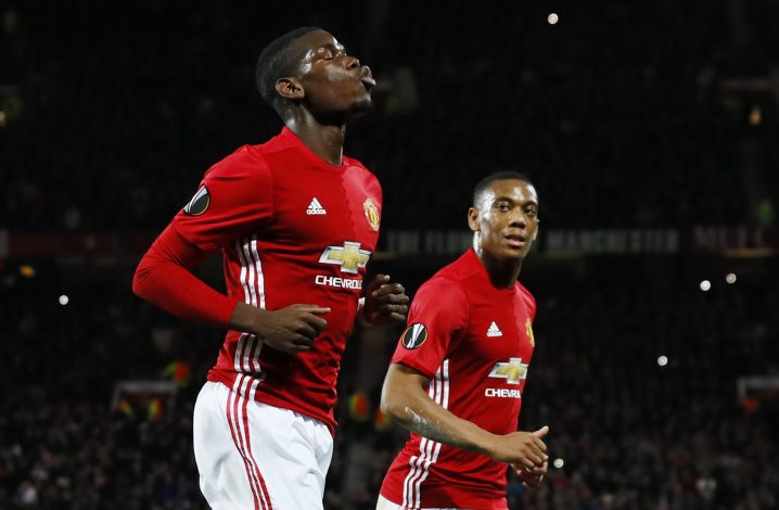 Britain Football Soccer - Manchester United v Fenerbahce SK - UEFA Europa League Group Stage - Group A - Old Trafford, Manchester, England - 20/10/16 Manchester United's Paul Pogba celebrates scoring their first goal from the penalty spot with Anthony Martial Action Images via Reuters / Jason Cairnduff Livepic EDITORIAL USE ONLY. - RTX2PRTW