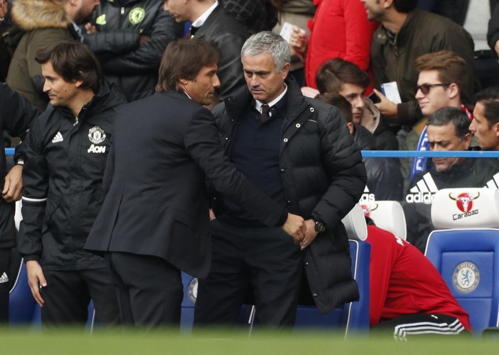 "Britain Soccer Football - Chelsea v Manchester United - Premier League - Stamford Bridge - 23/10/16 Chelsea manager Antonio Conte and Manchester United manager Jose Mourinho before the match  Action Images via Reuters / John Sibley Livepic EDITORIAL USE ONLY. No use with unauthorized audio, video, data, fixture lists, club/league logos or ""live"" services. Online in-match use limited to 45 images, no video emulation. No use in betting, games or single club/league/player publications.  Please contact your account representative for further details. - RTX2Q37H"