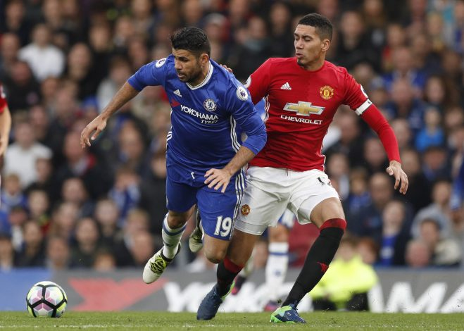 "Britain Soccer Football - Chelsea v Manchester United - Premier League - Stamford Bridge - 23/10/16 Chelsea's Diego Costa in action with Manchester United's Chris Smalling Action Images via Reuters / John Sibley Livepic EDITORIAL USE ONLY. No use with unauthorized audio, video, data, fixture lists, club/league logos or ""live"" services. Online in-match use limited to 45 images, no video emulation. No use in betting, games or single club/league/player publications. Please contact your account representative for further details. - RTX2Q3JA"