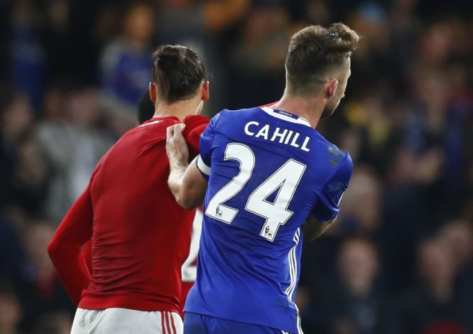"Britain Soccer Football - Chelsea v Manchester United - Premier League - Stamford Bridge - 23/10/16 Manchester United's Zlatan Ibrahimovic and Chelsea's Gary Cahill at the end of the match  Reuters / Eddie Keogh Livepic EDITORIAL USE ONLY. No use with unauthorized audio, video, data, fixture lists, club/league logos or ""live"" services. Online in-match use limited to 45 images, no video emulation. No use in betting, games or single club/league/player publications.  Please contact your account representative for further details. - RTX2Q3OL"