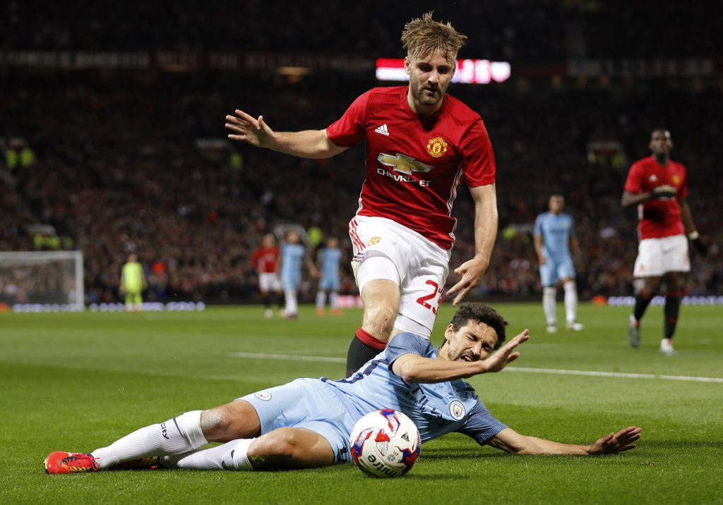 "Football Soccer Britain - Manchester United v Manchester City - EFL Cup Fourth Round - Old Trafford - 26/10/16 Manchester United's Luke Shaw in action with Manchester City's Jesus Navas Reuters / Darren Staples Livepic EDITORIAL USE ONLY. No use with unauthorized audio, video, data, fixture lists, club/league logos or ""live"" services. Online in-match use limited to 45 images, no video emulation. No use in betting, games or single club/league/player publications. Please contact your account representative for further details. - RTX2QLTU"