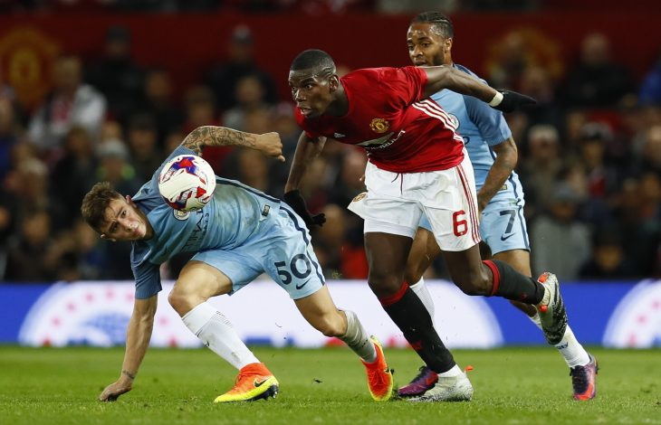 "Football Soccer Britain - Manchester United v Manchester City - EFL Cup Fourth Round - Old Trafford - 26/10/16 Manchester United's Paul Pogba in action with Manchester City's Pablo Maffeo Action Images via Reuters / Jason Cairnduff Livepic EDITORIAL USE ONLY. No use with unauthorized audio, video, data, fixture lists, club/league logos or ""live"" services. Online in-match use limited to 45 images, no video emulation. No use in betting, games or single club/league/player publications. Please contact your account representative for further details. - RTX2QM0X"