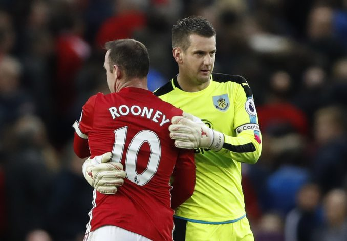 """Britain Football Soccer - Manchester United v Burnley - Premier League - Old Trafford - 29/10/16 Manchester United's Wayne Rooney and Burnley's Tom Heaton hug at full time Action Images via Reuters / Carl Recine Livepic EDITORIAL USE ONLY.No use with unauthorized audio, video, data, fixture lists, club/league logos or """"live"""" services. Online in-match use limited to 45 images, no video emulation. No use in betting, games or single club/league/player publications. Please contact your account representative for further details. - RTX2QZ94"""