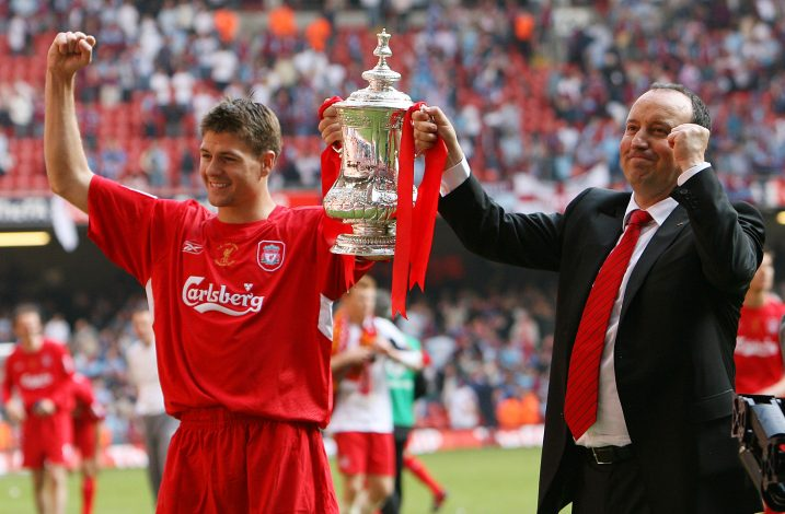 Liverpool's Steven Gerrard (L) and manager Rafael Benitez celebrate winning the English FA Cup after defeating West Ham United in the final at the Millennium Stadium in Cardiff, Wales May 13, 2006. REUTERS/Eddie Keogh - RTR1DCHZ