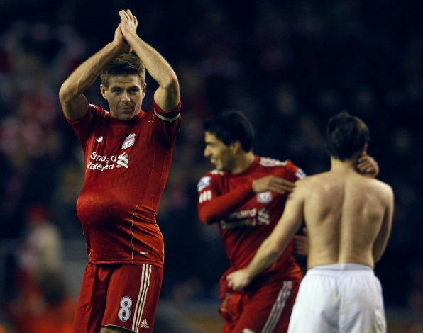 "Liverpool's Steven Gerrard (L) applauds as he walks off with the match ball after their English Premier League soccer match against Everton in Liverpool, northern England March 13, 2012. REUTERS/Phil Noble (BRITAIN - Tags: SPORT SOCCER) FOR EDITORIAL USE ONLY. NOT FOR SALE FOR MARKETING OR ADVERTISING CAMPAIGNS. NO USE WITH UNAUTHORIZED AUDIO, VIDEO, DATA, FIXTURE LISTS, CLUB/LEAGUE LOGOS OR ""LIVE"" SERVICES. ONLINE IN-MATCH USE LIMITED TO 45 IMAGES, NO VIDEO EMULATION. NO USE IN BETTING, GAMES OR SINGLE CLUB/LEAGUE/PLAYER PUBLICATIONS - RTR2ZALZ"