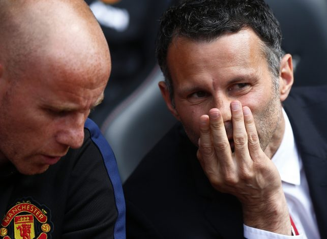 "Manchester United's interim manager Ryan Giggs (R) and assistant Nicky Butt chat before their English Premier League soccer match against Southampton at St Mary's Stadium in Southampton, southern England May 11, 2014. REUTERS/Andrew Winning (BRITAIN - Tags: SPORT SOCCER) FOR EDITORIAL USE ONLY. NOT FOR SALE FOR MARKETING OR ADVERTISING CAMPAIGNS. NO USE WITH UNAUTHORIZED AUDIO, VIDEO, DATA, FIXTURE LISTS, CLUB/LEAGUE LOGOS OR ""LIVE"" SERVICES. ONLINE IN-MATCH USE LIMITED TO 45 IMAGES, NO VIDEO EMULATION. NO USE IN BETTING, GAMES OR SINGLE CLUB/LEAGUE/PLAYER PUBLICATIONS - RTR3ONSP"