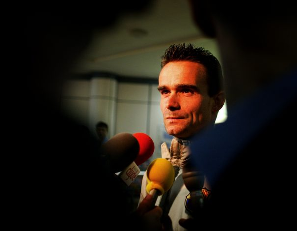 Barcelona's Dutch winger Marc Overmars talks to reporters after arriving at Glasgow airport before his team's March 11 UEFA Cup fourth round soccer match against Celtic, March 10, 2004. REUTERS/Jeff J Mitchell JJM/ASA/JB - RTRTYDE