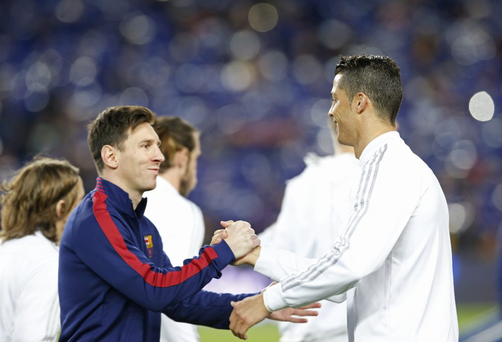 Football Soccer - FC Barcelona v Real Madrid - La Liga - Camp Nou, Barcelona - 2/4/16 Barcelona's Lionel Messi shakes hands with Real Madrid's Cristiano Ronaldo before the game Reuters / Albert Gea Livepic EDITORIAL USE ONLY. - RTSDADT