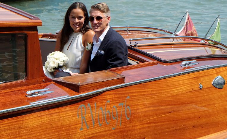 German football player Bastian Schweinsteiger and Serbian tennis player Ana Ivanovic sit in a boat after get married in Venice, Italy, July 12, 2016. REUTERS/Stringer FOR EDITORIAL USE ONLY. NO RESALES. NO ARCHIVES TPX IMAGES OF THE DAY - RTSHKNZ