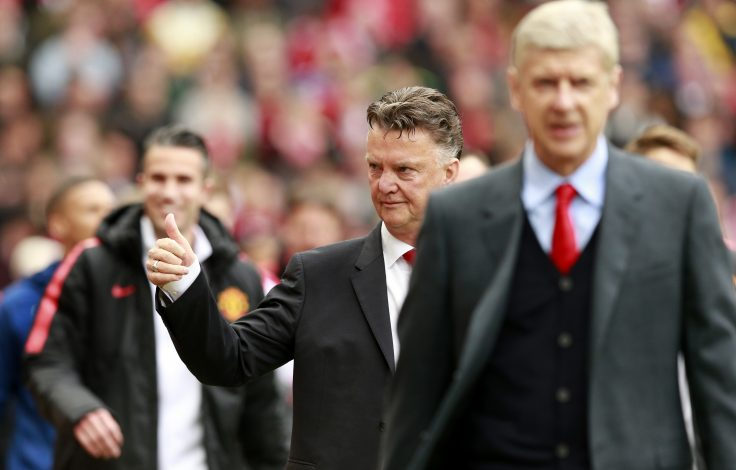 "Football - Manchester United v Arsenal - Barclays Premier League - Old Trafford - 17/5/15 Manchester United manager Louis van Gaal waves to fans before the game as Arsenal manager Arsene Wenger looks on Action Images via Reuters / Jason Cairnduff Livepic EDITORIAL USE ONLY. No use with unauthorized audio, video, data, fixture lists, club/league logos or ""live"" services. Online in-match use limited to 45 images, no video emulation. No use in betting, games or single club/league/player publications. Please contact your account representative for further details. - RTX1DBZR"