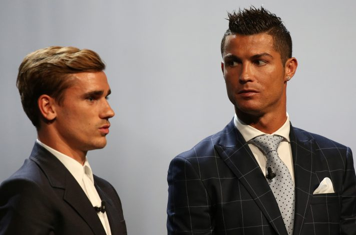 Real Madrid's Cristiano Ronaldo of Portugal (R) poses with French soccer player Antoine Griezmann after he received the Best Player UEFA 2015/16 Award during the draw ceremony for the 2016/2017 Champions League Cup soccer competition at Monaco's Grimaldi in Monaco, August 25, 2016. REUTERS/Eric Gaillard - RTX2N2DD
