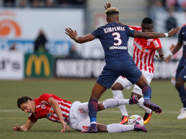 Football Soccer - Nancy v Paris Saint-Germain - French Ligue 1 - Marcel Picot stadium, Nancy, France - 15/10/16. Nancy's Joffrey Cuffaut challenges Paris Saint-Germain's Presnel Kimpembe . REUTERS/Vincent Kessler - RTX2OZ5L