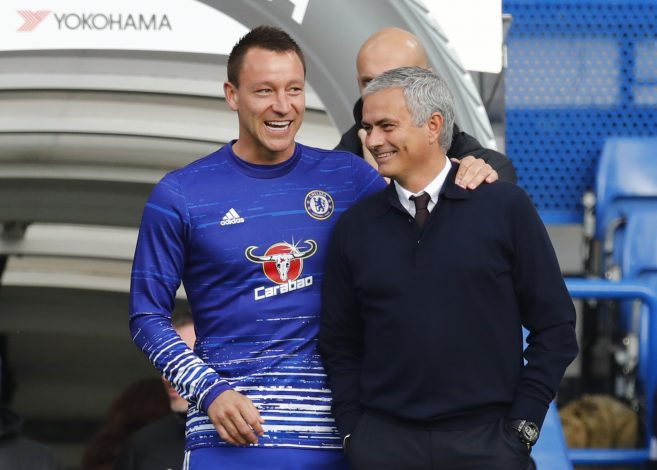 """Britain Soccer Football - Chelsea v Manchester United - Premier League - Stamford Bridge - 23/10/16 Manchester United manager Jose Mourinho speaks with Chelsea's John Terry before the match Reuters / Eddie Keogh Livepic EDITORIAL USE ONLY. No use with unauthorized audio, video, data, fixture lists, club/league logos or """"live"""" services. Online in-match use limited to 45 images, no video emulation. No use in betting, games or single club/league/player publications. Please contact your account representative for further details. - RTX2Q32M"""
