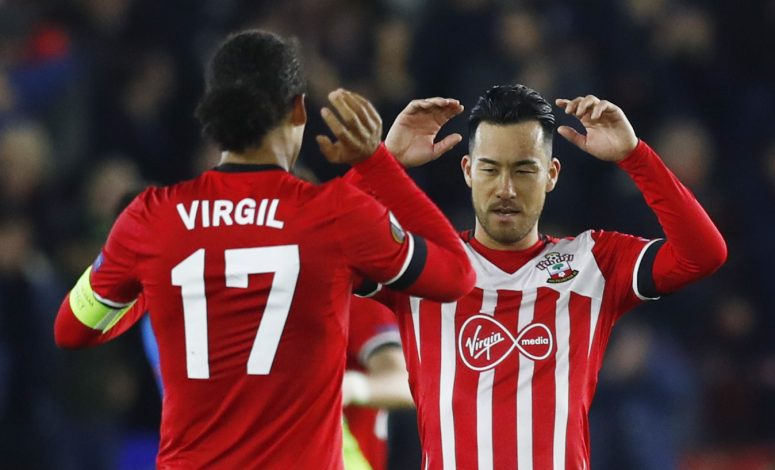 Britain Football Soccer - Southampton v Inter Milan - UEFA Europa League Group Stage - Group K - St Mary's Stadium, Southampton, England - 3/11/16 Southampton's Virgil van Dijk and Maya Yoshida celebrate after the match Reuters / Eddie Keogh Livepic EDITORIAL USE ONLY. - RTX2RTGM