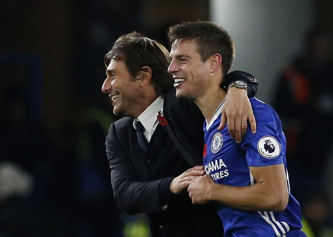 """Britain Football Soccer - Chelsea v Everton - Premier League - Stamford Bridge - 5/11/16 Chelsea manager Antonio Conte with Chelsea's Cesar Azpilicueta after the match Action Images via Reuters / Andrew Couldridge Livepic EDITORIAL USE ONLY. No use with unauthorized audio, video, data, fixture lists, club/league logos or """"live"""" services. Online in-match use limited to 45 images, no video emulation. No use in betting, games or single club/league/player publications. Please contact your account representative for further details. - RTX2S2TE"""
