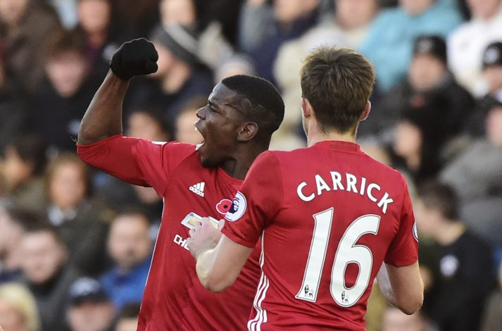 "Britain Football Soccer - Swansea City v Manchester United - Premier League - Liberty Stadium - 6/11/16 Manchester United's Paul Pogba celebrates scoring their first goal with Michael Carrick Reuters / Rebecca Naden Livepic EDITORIAL USE ONLY. No use with unauthorized audio, video, data, fixture lists, club/league logos or ""live"" services. Online in-match use limited to 45 images, no video emulation. No use in betting, games or single club/league/player publications. Please contact your account representative for further details. - RTX2S5SV"