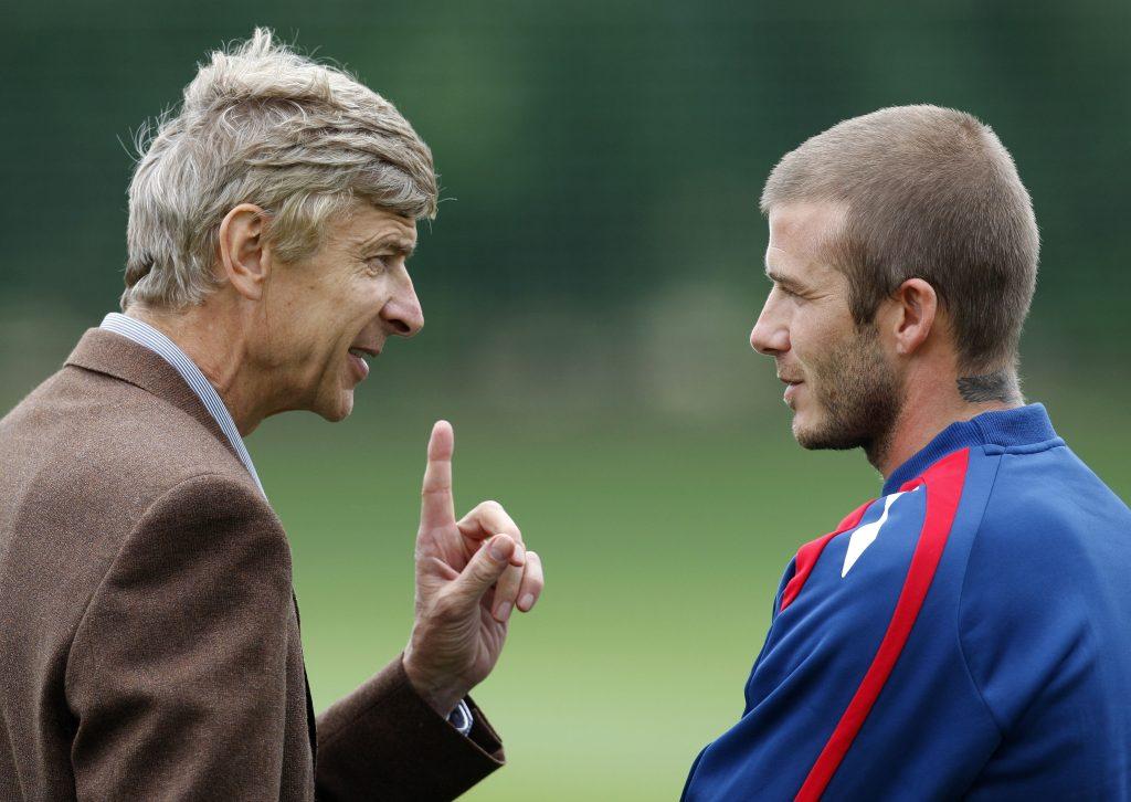 England's David Beckham (R) talks to Arsenal manager Arsene Wenger during an England training session.