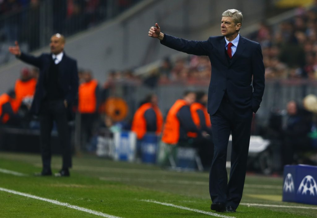 Arsene Wenger (R) reacts next to Pep Guardiola.