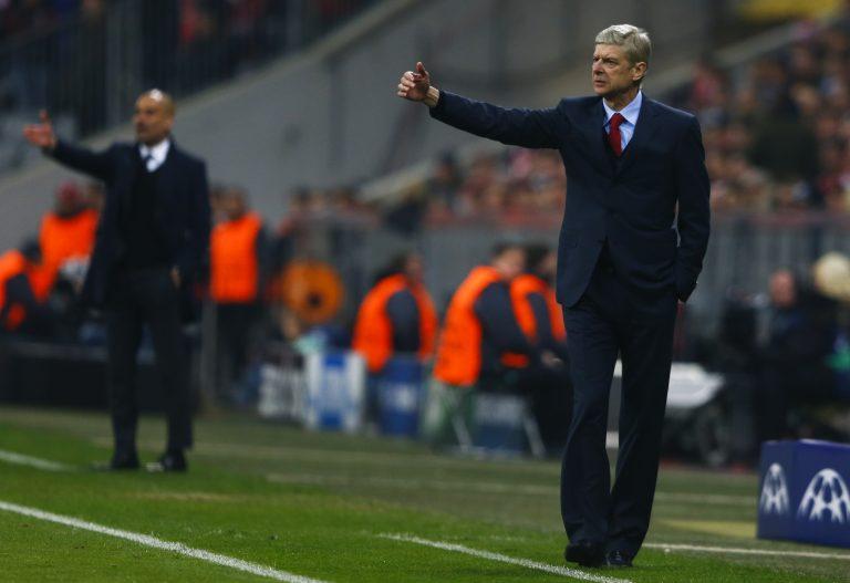 Arsene Wenger (R) reacts next to Pep Guardiola.
