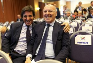 Juventus Sporting Director Giuseppe Marotta (R) and Torino president Urbano Cairo smile as they arrive at an election for the Italian Football Federation (FIGC) presidency in Rome.