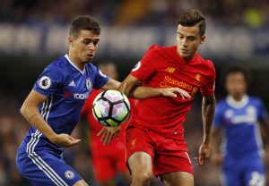 Chelsea's Oscar in action with Liverpool's Philippe Coutinho.
