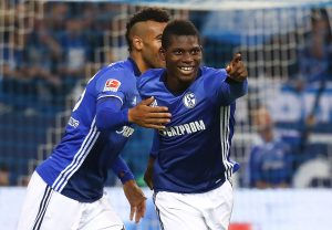 Schalke's Breel Embolo and Eric Maxim Choupo-Moting celebrate.