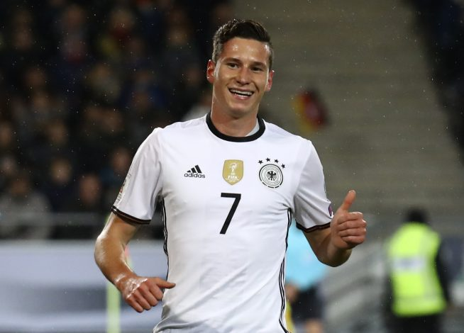 Germany's Julian Draxler celebrates scoring their first goal.