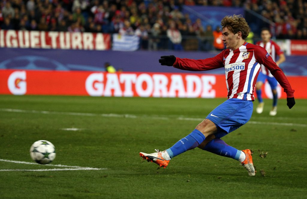 Atletico Madrid's Antoine Griezmann scores their second goal.