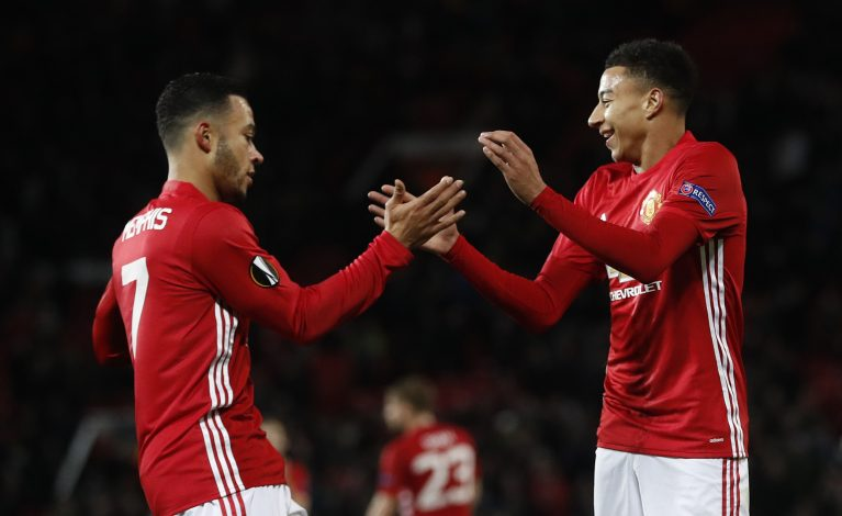 Jesse Lingard celebrates scoring their fourth goal with Memphis Depay.