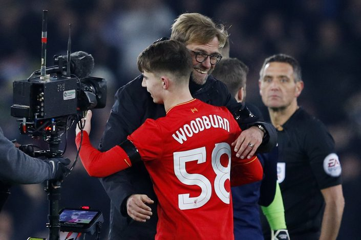 """Britain Football Soccer - Liverpool v Leeds United - EFL Cup Quarter Final - Anfield - 29/11/16 Liverpool's Ben Woodburn and manager Juergen Klopp celebrate after the game Reuters / Phil Noble Livepic EDITORIAL USE ONLY. No use with unauthorized audio, video, data, fixture lists, club/league logos or """"live"""" services. Online in-match use limited to 45 images, no video emulation. No use in betting, games or single club/league/player publications. Please contact your account representative for further details. - RTSTWQ0"""