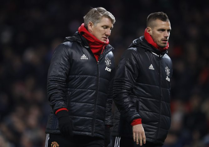 Bastian Schweinsteiger and Morgan Schneiderlin (R) at half time.